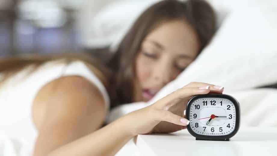 woman-sleeping-near-alarm-clock